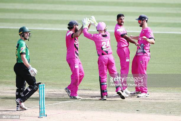 Ish Sodhi of the Knights celebrates with teammates for the wicket of Dane Cleaver of the Stags during the Super Smash Grand Final match between the...
