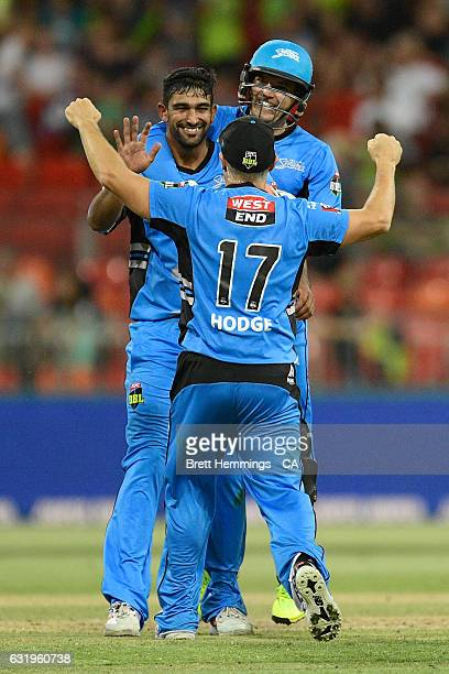 Ish Sodih of the Strikers celebrates with team mates after taking the wicket of Chris Green of the Thunder during the Big Bash League match between...