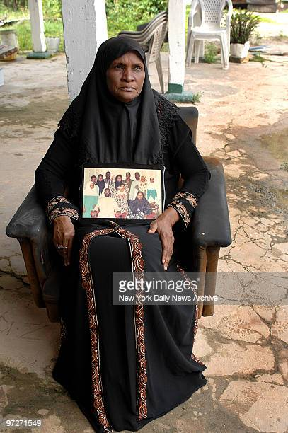 Isha Kadir wife of accused terrorist Abdul Kadir holds a family photo at their home on Riverside drive in Guyana Kadir is in prison in Trinidad for...