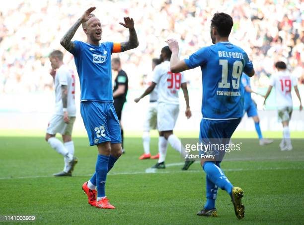 Ishak Belfodil of 1899 Hoffenheim celebrates with team mate Kevin Vogt of 1899 Hoffenheim after scoring their team's second goal during the...