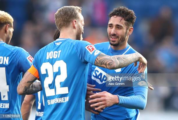 Ishak Belfodil of 1899 Hoffenheim celebrates with teammate Kevin Vogt after scoring his team's second goal during the Bundesliga match between TSG...