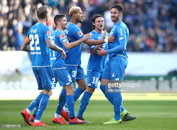 Ishak Belfodil of 1899 Hoffenheim celebrates with teammates after scoring his team's second goal during the Bundesliga match between TSG 1899...