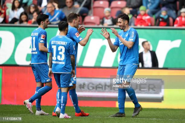 Ishak Belfodil of 1899 Hoffenheim celebrates with teammates after scoring his team's fourth goal during the Bundesliga match between FC Augsburg and...