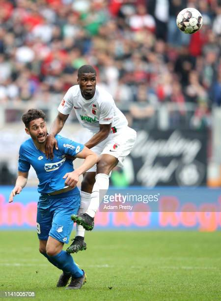 Ishak Belfodil of 1899 Hoffenheim competes for a header with Kevin Danso of Augsburg during the Bundesliga match between FC Augsburg and TSG 1899...