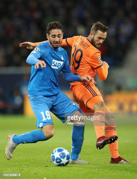 Ishak Belfodil of 1899 Hoffenheim is challenged by Lucas Tousart of Olympique Lyonnais during the Group F match of the UEFA Champions League between...