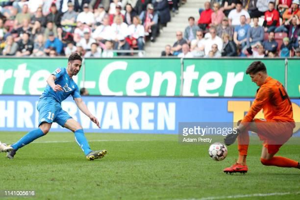 Ishak Belfodil of 1899 Hoffenheim scores his team's third goal during the Bundesliga match between FC Augsburg and TSG 1899 Hoffenheim at WWK-Arena...