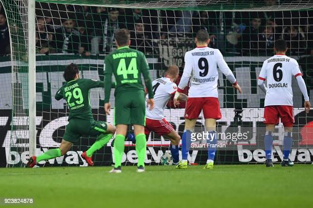 Ishak Belfodil of Bremen about to score a goal past Rick van Drongelen of Hamburg to make it 1:0 during the Bundesliga match between SV Werder Bremen...