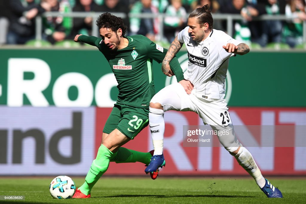 Ishak Belfodil (L) of Bremen and Marco Russ (R) of Frankfurt compete for the ball during the Bundesliga match between SV Werder Bremen and Eintracht Frankfurt at Weserstadion on April 1, 2018 in Bremen, Germany.