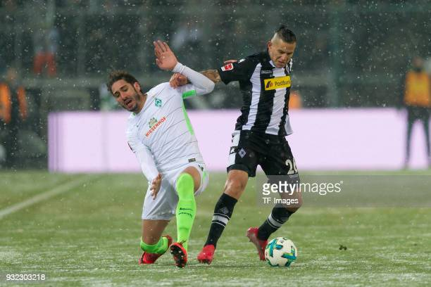 Ishak Belfodil of Bremen and Raul Bobadilla of Moenchengladbach battle for the ball during the Bundesliga match between Borussia Moenchengladbach and...
