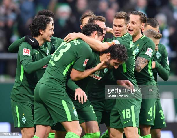 Ishak Belfodil of Bremen celebrates scoring the second goal with teamates during the Bundesliga match between SV Werder Bremen and 1 FSV Mainz 05 at...