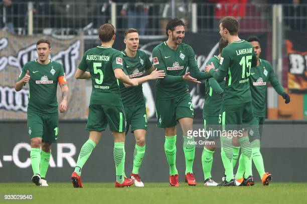 Ishak Belfodil of Bremen celebrates with his team after he scored a goal to make it 01 during the Bundesliga match between FC Augsburg and SV Werder...