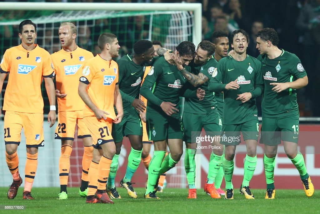 Ishak Belfodil (4th R) of Bremen celebrates with his team mates after scoriung his team's first goal during the DFB Cup match between Werder Bremen and 1899 Hoffenheim at Weserstadion on October 25, 2017 in Bremen, Germany.