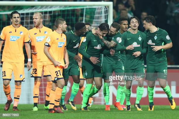 Ishak Belfodil of Bremen celebrates with his team mates after scoriung his team's first goal during the DFB Cup match between Werder Bremen and 1899...