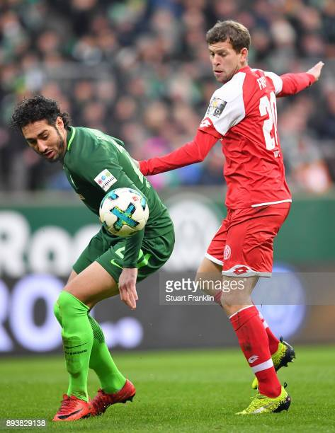 Ishak Belfodil of Bremen is challenged by Fabian Frei of Mainz during the Bundesliga match between SV Werder Bremen and 1 FSV Mainz 05 at...