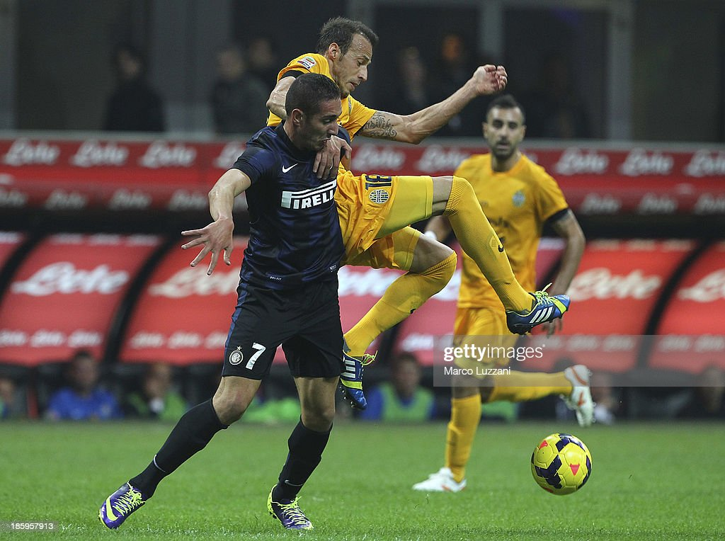 Ishak Belfodil of FC Internazionale Milano competes for the ball with Vangelis Moras of Hellas Verona FC during the Serie A match between FC Internazionale Milano and Hellas Verona at Stadio Giuseppe Meazza on October 26, 2013 in Milan, Italy.