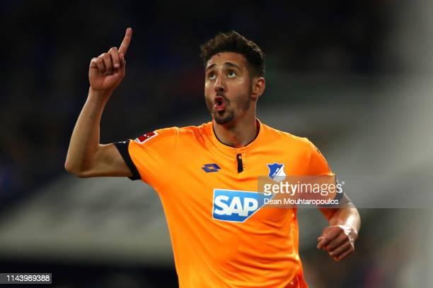 Ishak Belfodil of FC Schalke 04 celebrates after scoring his sides fifth goal during the Bundesliga match between FC Schalke 04 and TSG 1899...
