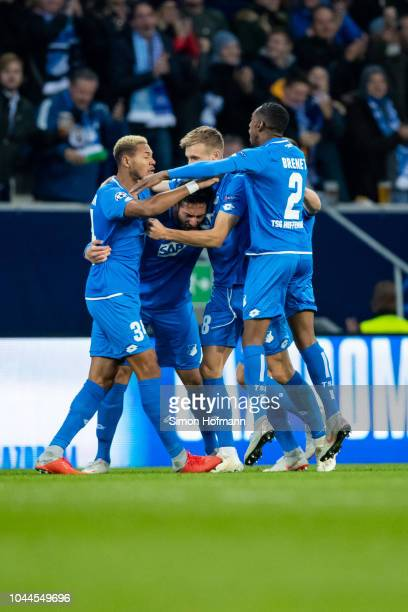 Ishak Belfodil of Hoffenheim celebrates his team's first goal goal with team mates during the Group F match of the UEFA Champions League between TSG...