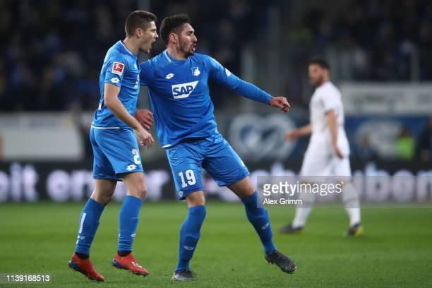 Ishak Belfodil of Hoffenheim celebrates his team's first goal with team mate Andrej Kramaric during the Bundesliga match between TSG 1899 Hoffenheim...
