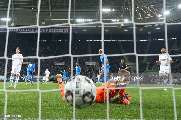 Ishak Belfodil of Hoffenheim celebrates scoring to make it 1-0 AS Lukas Hradecky of Leverkusen looks on during the Bundesliga match between TSG 1899...