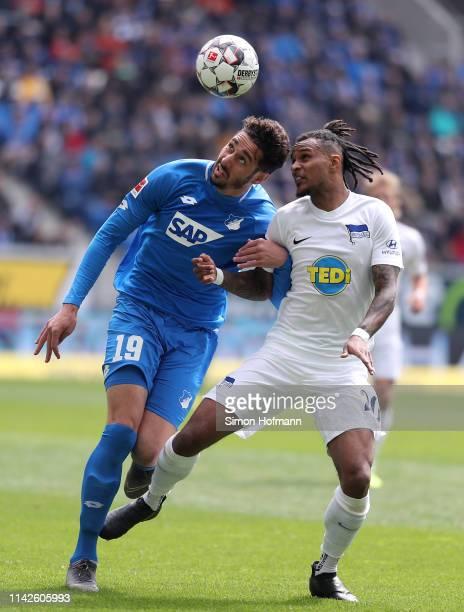 Ishak Belfodil of Hoffenheim is challenged by Valentino Lazaro of Berlin during the Bundesliga match between TSG 1899 Hoffenheim and Hertha BSC at...