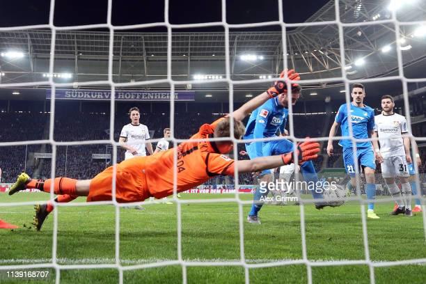 Ishak Belfodil of Hoffenheim scores a disallowed goal against goalkeeper Lukas Hradecky of Leverkusen during the Bundesliga match between TSG 1899...