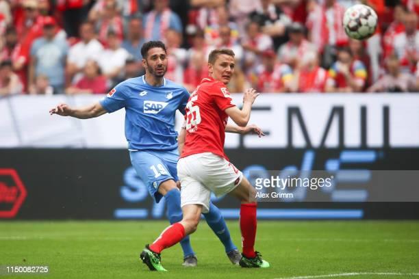 Ishak Belfodil of Hoffenheim scores his team's first goal past Niko Bungert of Mainz during the Bundesliga match between 1. FSV Mainz 05 and TSG 1899...