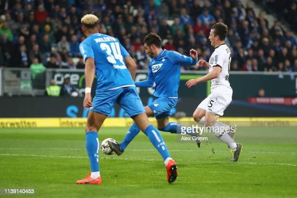 Ishak Belfodil of Hoffenheim scores to make it 1-0 with team mates during the Bundesliga match between TSG 1899 Hoffenheim and Bayer 04 Leverkusen at...