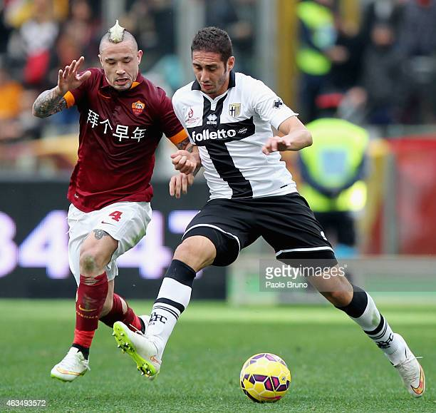 Ishak Belfodil of Parma FC competes for the ball with Radja Nainggolan of AS Roma during the Serie A match between AS Roma and Parma FC at Stadio...