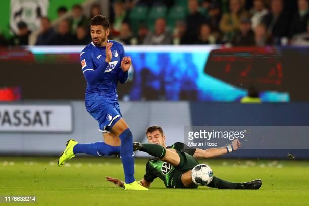 Ishak Belfodil of TSG 1899 Hoffenheim battles for possession with Yannick Gerhardt of VfL Wolfsburg during the Bundesliga match between VfL Wolfsburg...