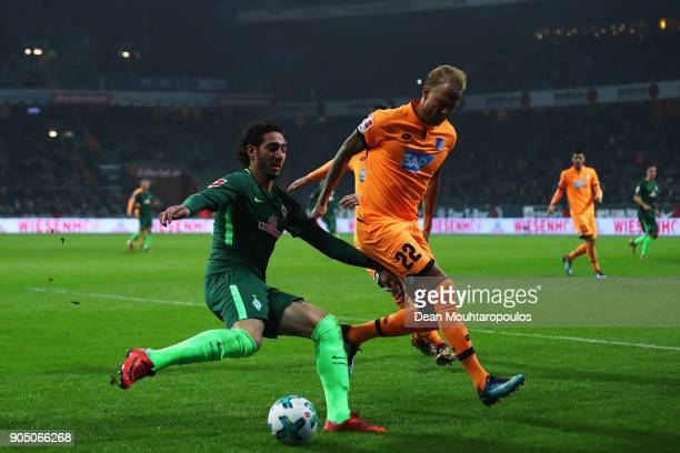 Ishak Belfodil of Werder Bremen battles for the ball with Kevin Vogt of TSG 1899 Hoffenheim during the Bundesliga match between SV Werder Bremen and...