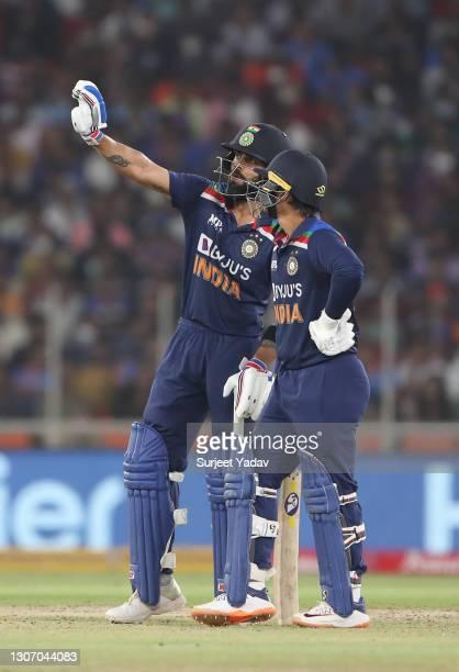Ishan Kishan and Virat Kohli of India interact during the 2nd T20 International match between India and England at Narendra Modi Stadium on March 14,...