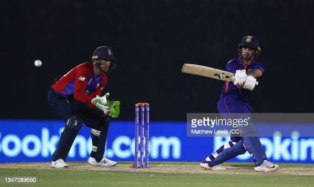 Ishan Kishan of India plays a shot as Jos Buttler of England looks on during the India and England warm Up Match prior to the ICC Men's T20 World Cup...
