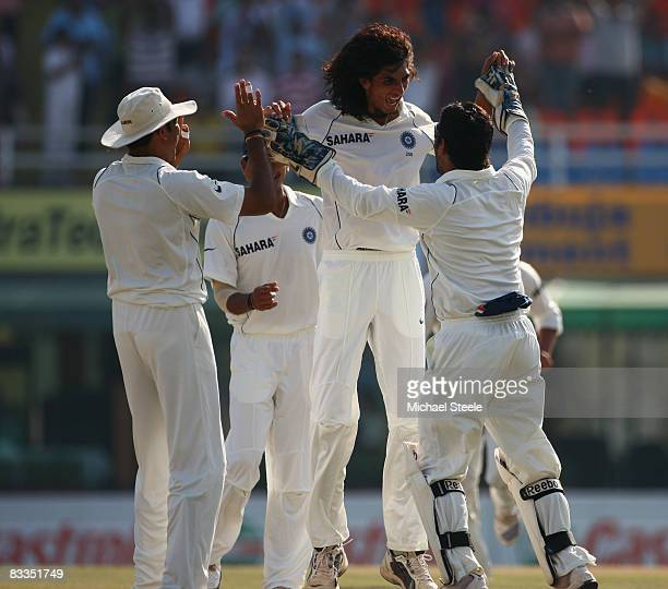 Ishant Sharma celebrates with MS Dhoni after taking the wicket of Shane Watson during day four of the Second Test match between India and Australia...