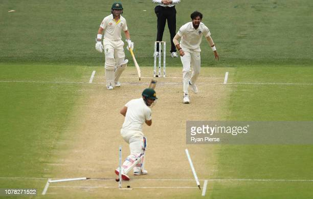 Ishant Sharma of India bowls Aaron Finch of Australia during day two of the First Test match in the series between Australia and India at Adelaide...