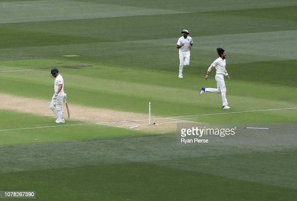 Ishant Sharma of India celebrates after taking the wicket of Aaron Finch of Australia during day two of the First Test match in the series between...