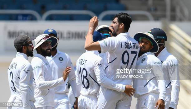 Ishant Sharma of India celebrates the dismissal of Jahmar Hamilton of West Indies during day 3 of the 2nd Test between West Indies and India at...