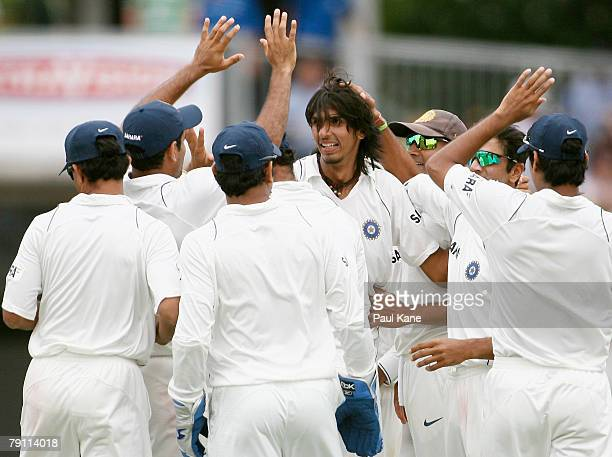 Ishant Sharma of India is congratulated after taking the wicket of Ricky Ponting of Australia during day four of the Third Test match between...