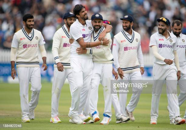 Ishant Sharma of India is hugged by India captain Virat Kohli after taking the wicket of Jonny Bairstow of England during day five of the second Test...