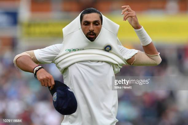 Ishant Sharma of India takes his cap and jersey after finishing an over during the Specsavers 5th Test Day Two between England and India at The Kia...