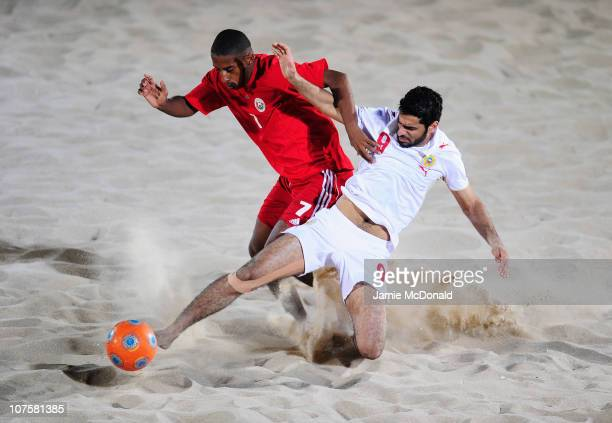 Ishaq Al Mas Al Qassmi of Oman and Mohamed Alsharqawi of Bahrain fight for the ball in the Men's Beach Soccer Quarterfinal match between Oman and...