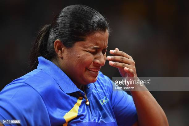 Ishara Manikku Badu of Sri Lanka reacts during the Table Tennis Women's Team preliminary rounds against Anna Hursey of Wales on day two of the Gold...