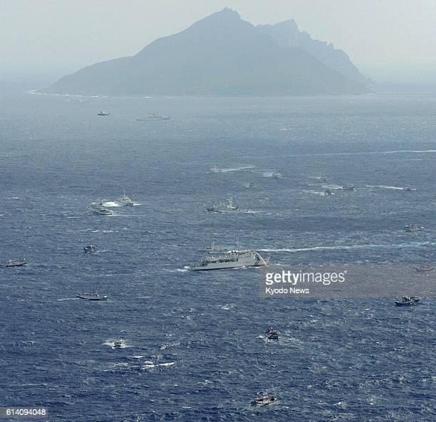 Ishigaki Japan Photo from a Kyodo News aircraft shows Taiwan boats and a Japan Coast Guard patrol ship in Japanese territorial waters near Uotsuri...