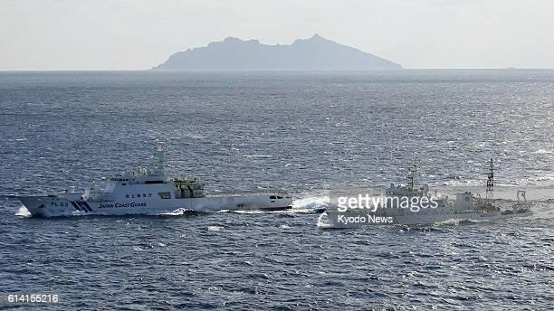 Ishigaki Japan Photo taken from a Kyodo News airplane shows a Japan Coast Guard patrol ship and a Chinese maritime surveillance vessel near Uotsuri...