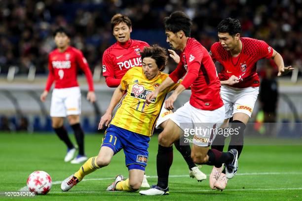 Ishihara Naoki of Vegalta Sendai competes with Abe Yuki of Urawa Red Diamonds during the 98th Emperor's Cup Final between Urawa Red Diamonds and...