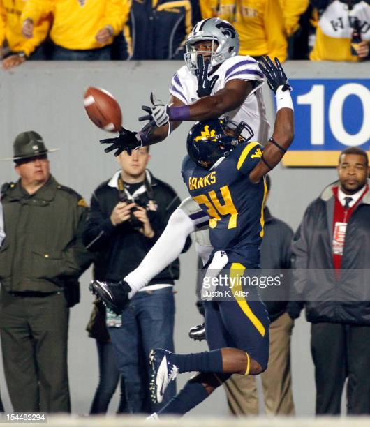 Ishmael Banks of the West Virginia Mountaineers is called for pass interference against Chris Harper of the Kansas State Wildcats during the game on...