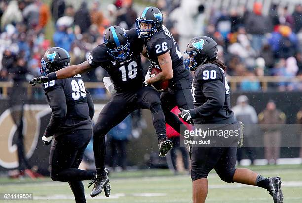 Ishmael Hargrove and Ryan Williamson of the Buffalo Bulls celebrate after recovering a fumble in the second quarter against the Western Michigan...