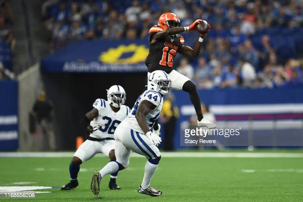Ishmael Hyman of the Cleveland Browns catches a pass in front of Derrick Kindred of the Indianapolis Colts during the second half of a preseason game...