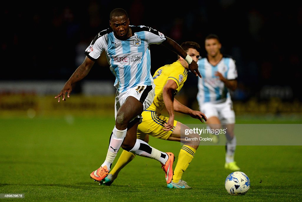 Ishmael Miller of Huddersfield Town gets past Eric Lichaj of Nottingham Forest during the Sky Bet Championship match between Huddersfield Town and Nottingham Forest at John Smiths Stadium on September 24, 2015 in Huddersfield, England.
