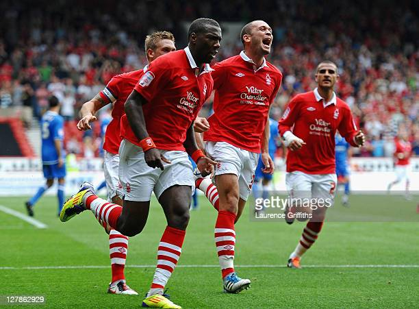 Ishmael Miller of Nottingham Forest celebrates scoring the opening goal with Joel Lynch and Luke Chambers during the npower Championship match...