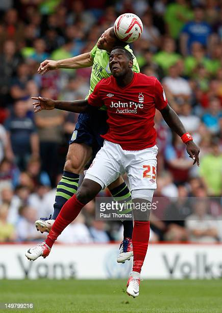 Ishmael Miller of Nottingham Forest in action with Ron Vlaar of Aston Villa during the preseason friendly match between Nottingham Forest and Aston...
